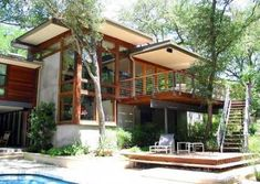 Treehouse Austin for a Modern Exterior with a Exterior Stain and Taylor Slough Creek House_Back Elevation by Tom Hurt Architecture Thai House, Modern Tropical House, Tropical Houses, Tropical House Design, Rest House, House In The Woods, House Architecture Styles, Modern Architecture, Style At Home