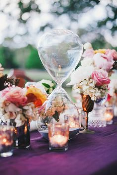 hourglass sand clock centerpiece // photo by Renee Nicole Design + Photography // styling by One Stone Events // view more: http://ruffledblog.com/time-travelers-wife-wedding-ideas/