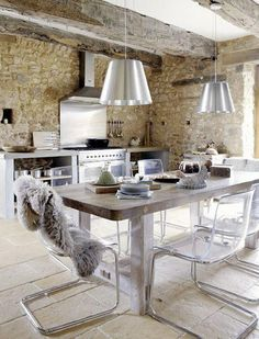 Modern rustic kitchen: Old stone walls, stainless steel stove and backsplash, rustic wood table, lucite and chrome dining chairs. Vintage House in Dordogne, France Küchen Design, Design Case, Interior Design, Design Ideas, Modern Interior, Scale Design, Traditional Interior, Stone Interior, Design Homes