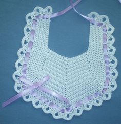 Baby Bib in White with Lavender Hand Crocheted Baby Bib is made in White cotton thread with interwoven Light Lavender ribbon and bow. Created in the USA. PH-1385 $23.50 + S/H