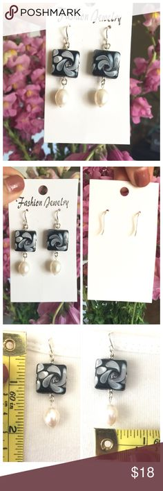 Handmade Freshwater Pearl Dangle Earrings One of a kind handmade ceramic & freshwater pearl dangle earrings. Sterling silver hook. Please refer to picture for measurements. Made by Armalyn's creations for ReviveMe Thredz. Let me know if you have any questions. Thank you for stopping by. Handmade Jewelry Earrings