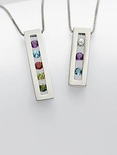 I want one of these with all four of our birthstones in it. Pretty...