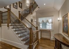 Traditional Staircase with High ceiling, Hardwood floors, Pendant light