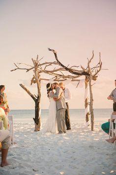 Driftwood wit its beautifully gnarled appearance makes the perfect beach wedding arbor. Source: ruffledblog.com #beachwedding #weddingarbor