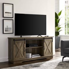 Creative ideas for DIY TV stand plans, very cheap and easy to do. Find the perfect TV Stand for your TV with any sizes. Diy Screen Door, Sliding Screen Doors, Diy Door, Tv Stand Plans, Wood Barn Door, Barn Style Doors, Barn Doors, Cool Tv Stands, Fireplace Tv Stand