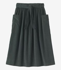 Button-back skirt in a soft, fine needlecord. Integral self fabric belt - tied at the front. Two large patch pockets. Fits neatly at the waist and over the hips.