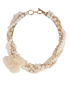 Very pretty & feminine pearl and lace necklace.  And for only $6.80.  Love it.