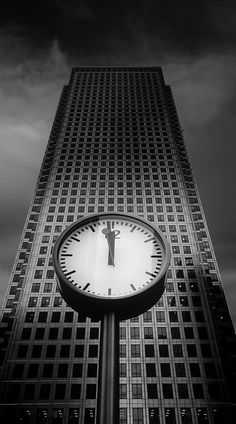 Taken at Canary Wharf, London. This clock is one of five, prominently displayed in front of the HSBC tower - presumably to remind lunching financiers that they should hurry up and get back to work. England Uk, London England, Places Around The World, Around The Worlds, Unique Clocks, Somewhere In Time, Before Midnight, Black White Art, London Calling