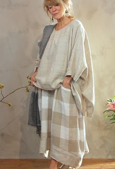 Santany Top  in linen £189 with Linen Shawl £65, over Emily Skirt £245.