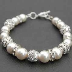Bridal Ivory Pearl Rhinestone Bracelet, Bling Wedding Jewelry, Bridesmaid Gift. $24.00, via Etsy.