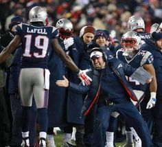 Foxborough, MA 01/10/15 Offensive coach Josh Daniels celebrates with Brandon LaFell after LaFell made a touchdown in the fourth quarter at Gillette Stadium Saturday, January 10, 2015. AFC Divisional Playoff Game between the New England Patriots and the Baltimore Ravens. (Jim Davis/Globe Staff)