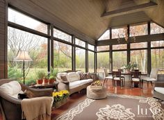 Outdoor porch enclosed for year round use...with amazingly beautiful views.. Old-World Beauty Modernized For Comfort
