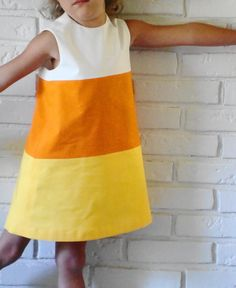 I want to make Ellie a candy corn Sweet Little Dress while she's still little enough to let me. I just bought some orange polka dot fabric...
