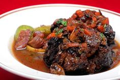 Haitian-Style Oxtail Recipe From SBWFF Tap Tap Relief Headliner Kris Wessel replace cooking oil with coconut oil Oxtail Recipes Crockpot, Meat Recipes, Wine Recipes, Cooking Recipes, Donut Recipes, Cuban Recipes, Savoury Recipes, Recipies, Haitian Food Recipes