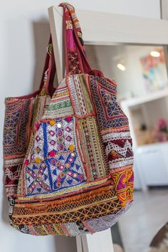 An Artist's Modern Menswear-Inspired Style — Real People, Real Fashion Inspiration. This hand-embroidered bag, found last summer at a market in Ibiza, Spain, is one of Olesya's favorite accessories.