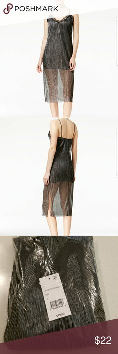 Shift  Metallic lace trim dress. Brand new juniors metallic dress. Slits on both sides and approx 38.5 inches from the shoulder down, not including lenght of strap. Shift Dresses