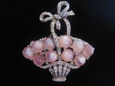 Vintage Coro Pink Moonstone Cab Flower Basket-Pin Pegasus Mark available at Vintage Jewelry Lounge on Ruby Lane.  http://www.rubylane.com/item/492448-VJL-567/Vintage-Goldtone-Rhinestone-Dancing-Couple