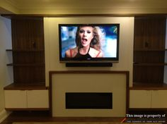sony tv mounted on a custom built wall over fireplace in a basement of a house. hdmi cables were pre-wired when custom wall was getting built. Tv Over Fireplace, Fireplace Wall, Living Room With Fireplace, Tv Stand Room Divider, Tv Stand Shelves, Swivel Tv Stand, Tv Installation, Big Screen Tv, Modern Basement