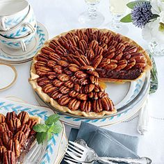 Dazzling Thanksgiving Pies | Salted Caramel-Chocolate Pecan Pie | SouthernLiving.com :Pie Shop #pie #shop #atlanta #buckhead #slice #dessert #yum #sweet #baking #kitchen #tradition #sweet #savory #lunch #pieshop #wedding #birthday #specialorder www.the-pie-shop.com