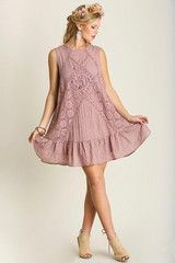 """https://alittlebirdboutique.com/collections/dresses/products/moonlight-serenade-dress Moonlight Serenade Dress- $39.00  Sleeveless lace accented baby doll dress with ruffled hem and diamond back cut-out.  Fully Lined - Available in Moss and Mauve  65%Cotton 35%Polyester  34"""" Length - Shoulder Seam to Hem (Large)"""