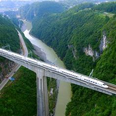 Photos taken on July 28, 2016 show a high-speed train running on the…