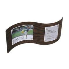 Strong rare earth magnets magically hold photos to these magnetic wood picture frames. Featuring a unique curved surface, these real bamboo and walnut frames complement the elegance of your desktop or tabletop.