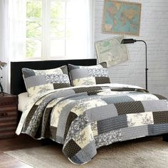 The Concord King Quilt Set by Olivia's Heartland features rectangular blocks in ivory, black, and grays .Perfect for your country primitive home or cabin decor
