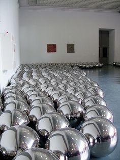 Yayoi Kusama big metallic ball sculptural installation ...very intriguing and absorbing art work