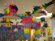 Mexican Pinatas filled with candy.  These little pinatas made by the children are hanging from the ceiling around a real pinata.