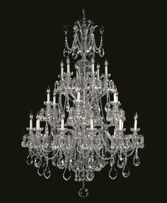 Prague has been a pillar of the Bohemian Classic line for more than 50 years. A contemporary version of this classic chandelier, created with irregularly hung trimmings of different sizes accentuated with a Marea finish, is just one example of the ease with which is can be adapted to contemporary style.  #Prague #TimelessHeritageCatalogue #Chandelier #LightingDesign #BohemianCrystal