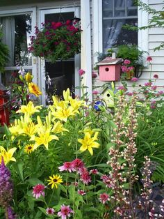 Summer cottage garden... picket fence butterfly garden ideas for front corner picket fence.
