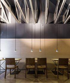 Origo Coffee Shop by Lama Architectura Couleur plafond quui retombe sur les murs, puis faïence.