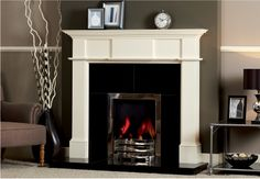 Solid Fuel Open Fires - only certain materials can withstand the tremendous radiant heat created from an open fire. We can show you the most gorgeous and yet the safest combinations available. Log Burner Fireplace, Wooden Fireplace, Fireplace Design, Electric Fire And Surround, Focus Fireplaces, Wooden Fire Surrounds, Fireplace Showroom, Classic Fireplace, Curved Walls