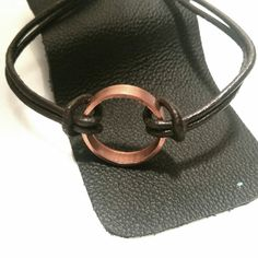 Genuine upcycled copper pipe circle with quality distressed brown leather cord. *NOTE - copper may darken some with wear as this is normal patina. Claw clasp closure. Choose bracelet length at checkou