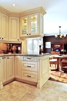 Modest Kitchen And Dining Room Decoration Interior. I like the tall crown moulding.