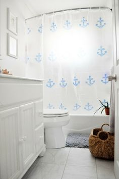 Chic Beach Cottage Bathroom With A Clear Anchor Shower Curtain On Curved Rod