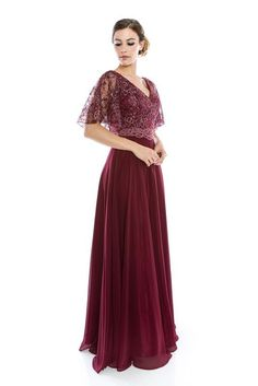 Embroidered, Beaded long Mother of the Bride Dress in Wine Color.. With Floral Lace Sheer Short Sleeves.. beading on the waist as well. Zipper closure.. Available in Sizes M - 3X ( Please review the s
