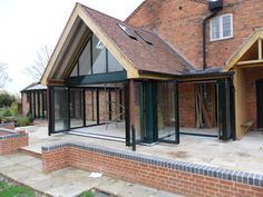 Corner Post Bifold Doors and Gable End Windows - with that overhang that provides shelter, privacy and wildlife homes House Extension Design, Glass Extension, Roof Extension, House Design, Extension Ideas, Conservatory Extension, Extension Designs, Patio Design, Bungalow Extensions