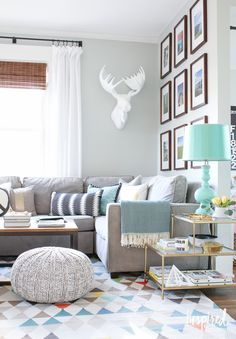The Terrace Gold and glass side table looks great in this grey and turquoise living room | Spring Living Room | inspiredbycharm.com