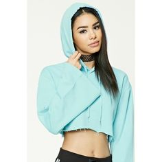 Forever21 Cropped Raw-Cut Hem Hoodie ($20) ❤ liked on Polyvore featuring tops, hoodies, aqua, cropped hoodies, blue crop top, long sleeve crop top, blue hoodies and cropped hooded sweatshirt