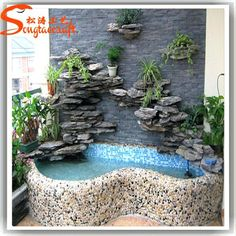 Indoor waterfalls offer the complete combination of sophisticated brilliance and natural relaxation. When it's set up in the living room, game room, dining room, hallway or wherever else inside the home. Indoor Waterfall Fountain, Indoor Wall Fountains, Indoor Pond, Tabletop Water Fountain, Indoor Fountain, Pool Waterfall, Water Fountains, Indoor Waterfall Wall, Backyard Water Feature