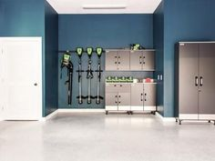 The home's well-organized garage includes a workstation, smart storage solutions and interior walls painted a deep shade of teal