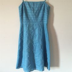 !!Ann Taylor Petite Sundress!! ** Ann Taylor Arctic SunDress**   • Very Unique Dress  • 100% Linen  • In Great Condition  • Spaghetti Straps  • Hits above the knee  • Great Pattern Details in the Linen Ann Taylor Dresses