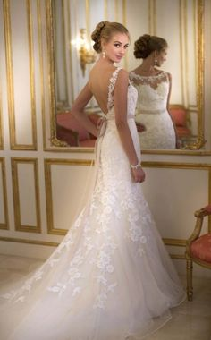 Stella York fitted lace mermaid wedding dress with Illusion neckline and shoulder straps at Blessings of Brighton