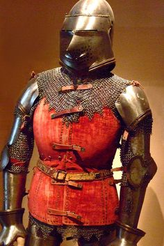 Armor Italian about 1400 CE featuring an early form of brigandine - a torso defense constructed of numerous overlapping plates riveted inside a doublet Steel brass and textile (1) by mharrsch, via Flickr