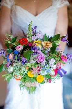 Rustic, wild flower, colourful wedding bouqet, via 'A Homemade and Colourful Wild Meadow Summer Wedding'.  Photographed by http://www.katherineashdown.co.uk/
