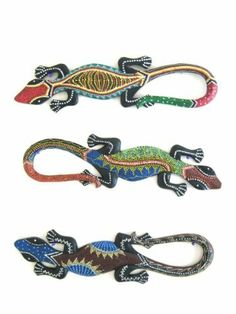 Gecko Wall Hanging Lizard Statue Aboriginal Wall Decor - Assortment by World Bazaar Imports. $12.99. Fair Trade Item. Handcarved by skilled artisans. Price Per Piece- Assortment shown. Handmade- Allow for variances and minor imperfections. Nice for any Tiki or Tropical Decor. A common sight all over Bali, the playful gecko is often the subject of handicrafts and sculptures. Bring the tropical nature into your home with this handcarved sculpture enhanced by a traditi...