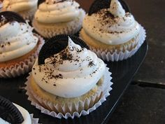 amazing Oreo cupcakes with an oreo half baked inside the cupcake!