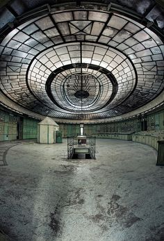 This the abandoned control room in an unused part of a thermal power plant near Budapest, Hungary. The control room, with its Art Deco opal glass ceiling, was designed by Hungarian architect Reichl Kalman in 1926. It is listed and protected by law so that it can't be demolished, but it is not being maintained or preserved and is not open to the public.