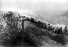 An execution of Jews in July 1942 in the occupied Soviet Union.  Jewish Soviet citizens were shot by German soldiers. (the photograph was found on the body of a German officer at the end of July, 1942)